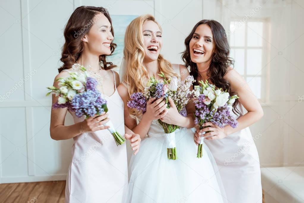 laughing bride with bridesmaids