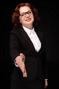 Businesswoman holding hand for handshake