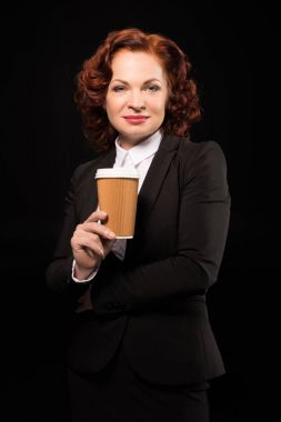 Businesswoman with disposable coffee cup