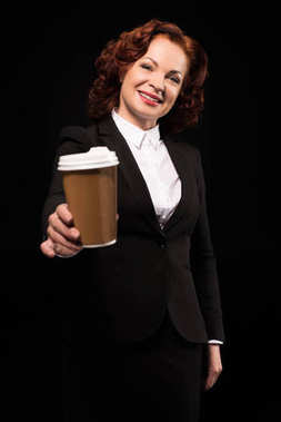 Businesswoman holding out coffee cup