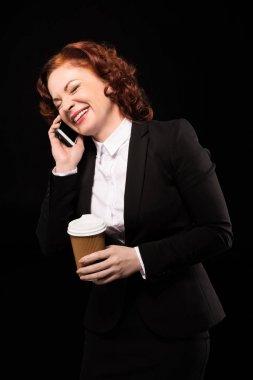 Laughing businesswoman talking on phone
