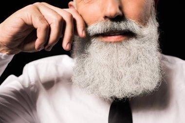 man twisting moustache