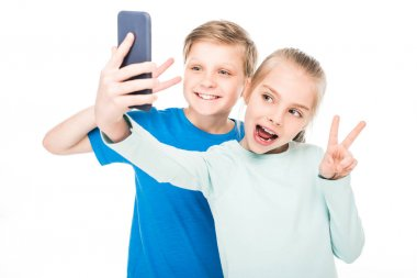children taking selfie with smartphone