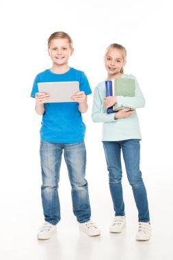 children with books and digital tablet