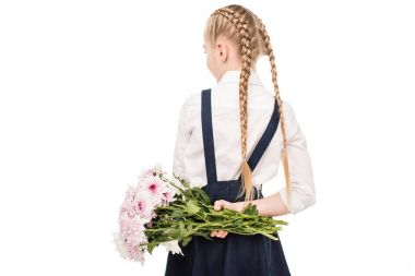 child holding bouquet of flowers