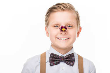 boy with flower on nose