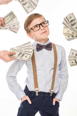 little boy with dollar banknotes