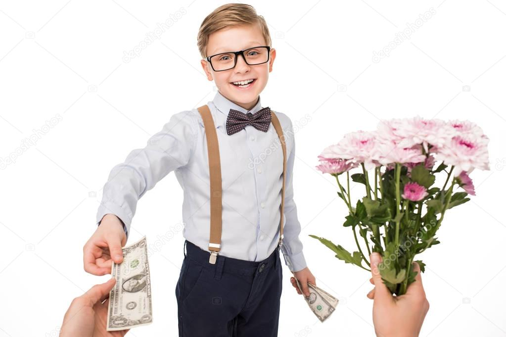 little boy buying flowers