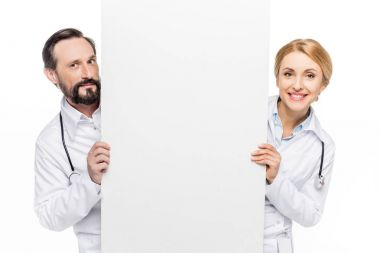 doctors holding blank banner