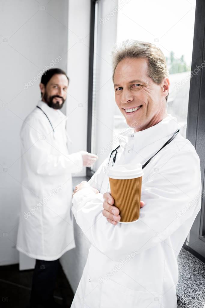 doctor drinking coffee to go