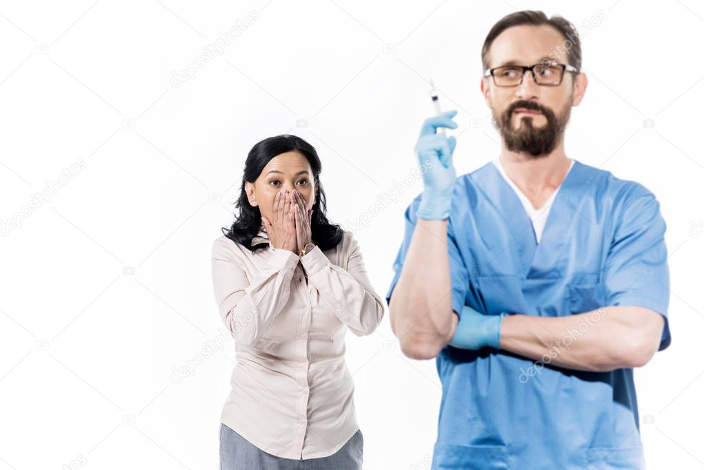 scared patient and doctor with syringe