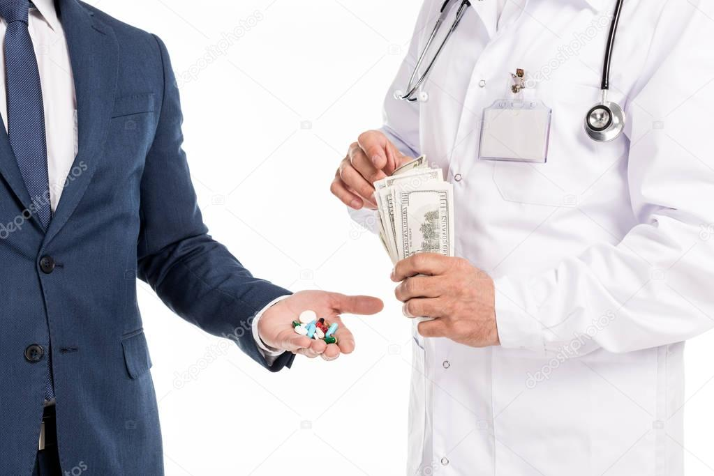 businessman buying pills from doctor