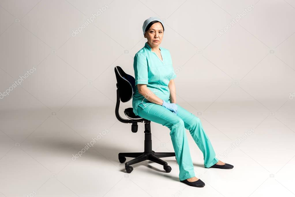 asian doctor sitting on chair