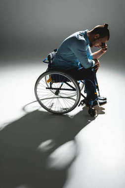 Despaired man in wheelchair