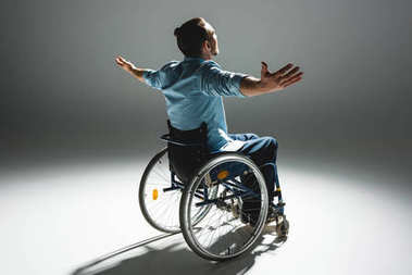Disabled man posing with arms outstreched