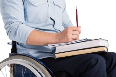 man in wheelchair with books