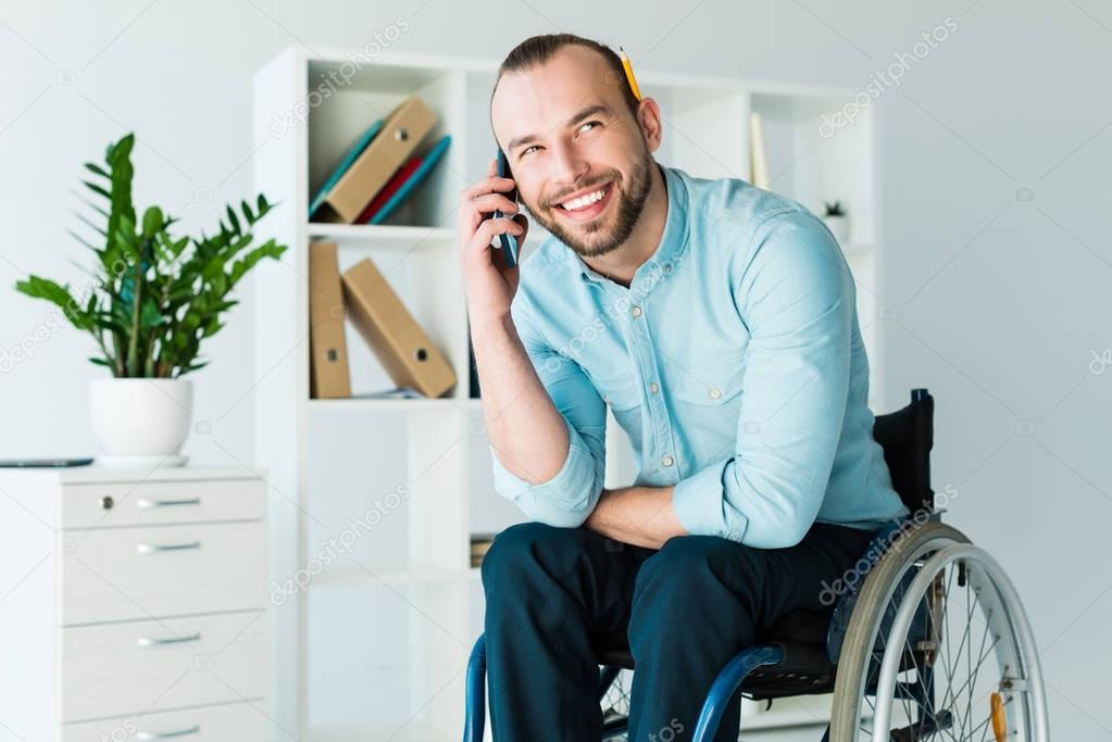 Disabled businessman talking on phone