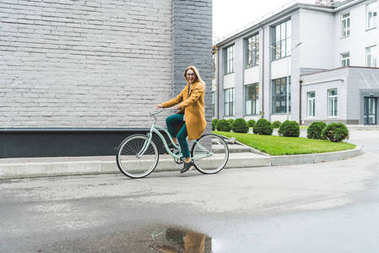 stylish woman on bicycle