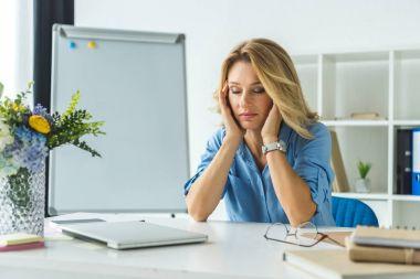 tired businesswoman with headache