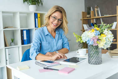 businesswoman working with digital devices