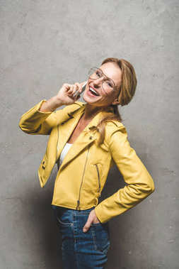 excited woman talking on smartphone