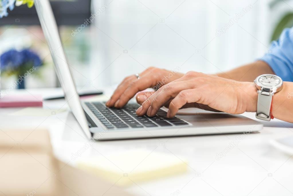 businesswoman typing in laptop