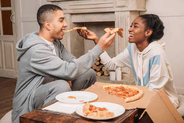 couple sharing pizza slices