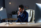 businessman sitting and coughing at working place