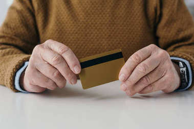 Close-up view of senior man holding credit card stock vector
