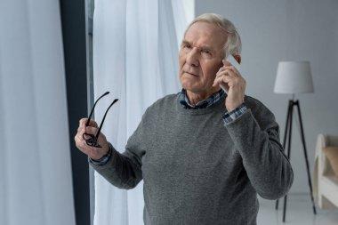 Senior confident man making a phone call