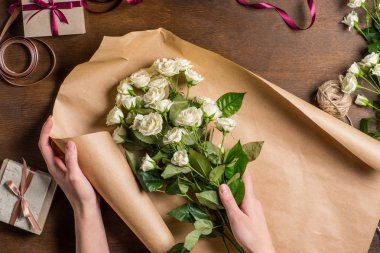 white roses in hands