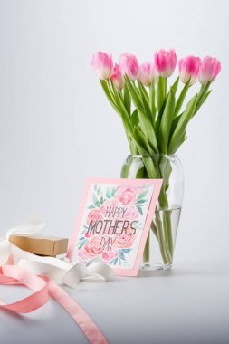 Beautiful pink tulips in vase, happy mothers day postcard and gift stock vector