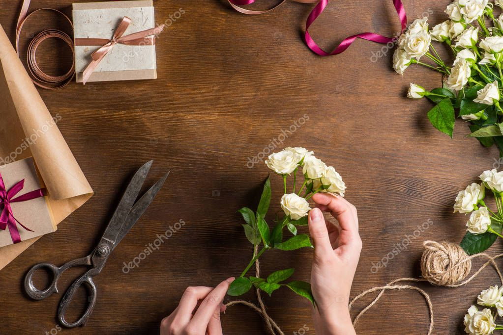 hands holding roses