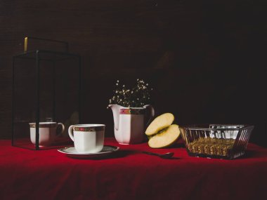 still life with a cup of coffee and apple