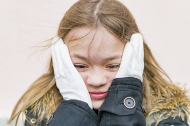 Young girl in white protective gloves on the street