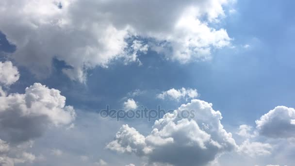 White clouds disappear in the hot sun on blue sky. Time-lapse motion clouds blue sky background. Blue sky. Clouds. Blue sky with white clouds