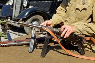 German machine guns MP-40 in the hands of Soviet soldier