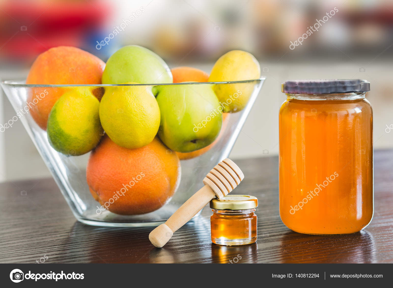 Big And Small Glass Jar Of Honey With Wooden Spoon And Bowl Of