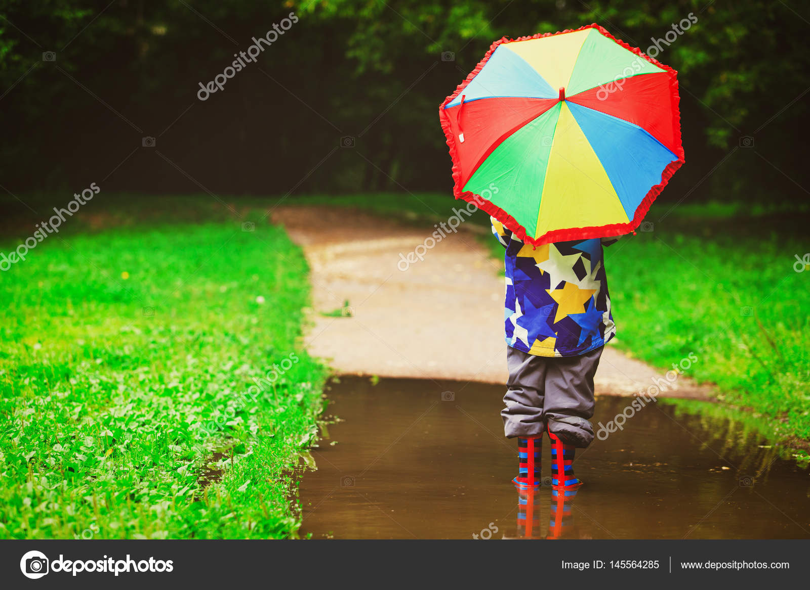 little boy with colorful umbrella play in water — Stock Photo ...