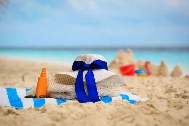 bag, suncream, glasses on beach