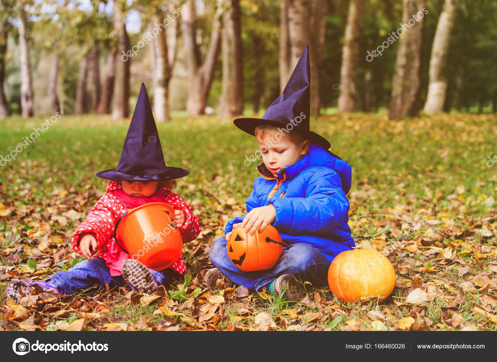 kids in halloween costume play at autumn trick or treating stock photo