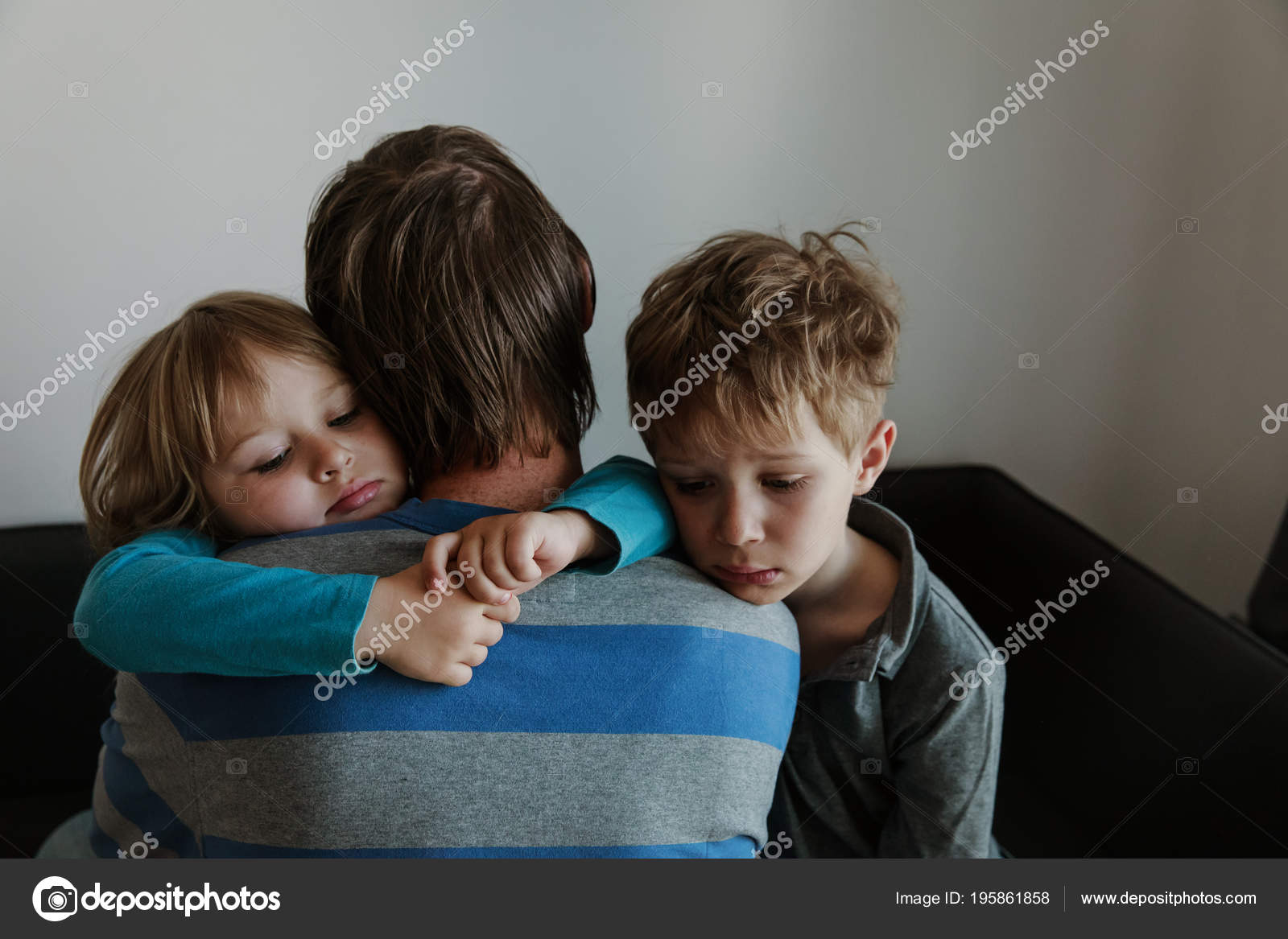 sad little boy and girl hugging father family in sorrow stock