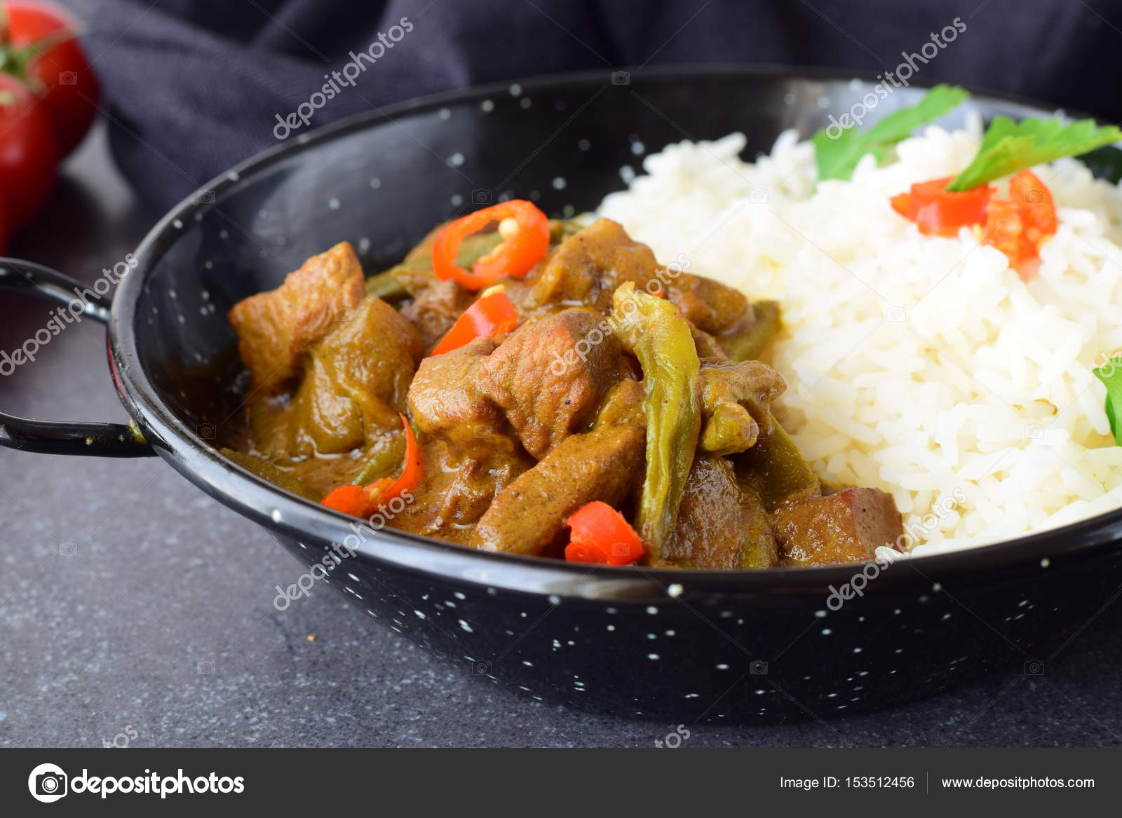Pork In Spicy Curry Sause With Eggplant And Green Beans, Served With Cooked  Rice In A Black Metal Bowl On A Grey Abstract Background. Home Cooking.