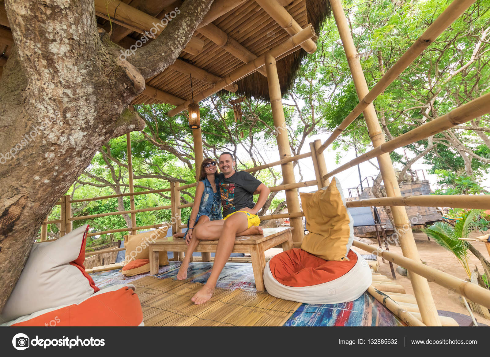 Happy Young Romantic Caucasian Couple In Gazebo On The Tree