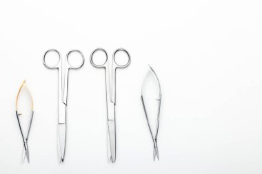 Steel surgical tools and laboratory equipment isolated on a white background. Professional clinic instruments. Medical, surgery, ambulance and veterinarian concept. Closeup with soft selective focus