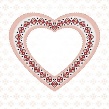 Pink embroidered heart on a light background