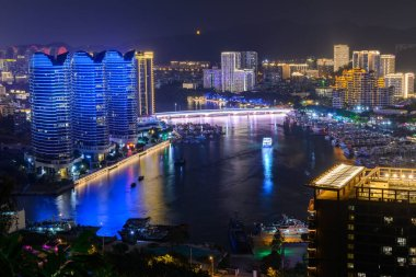 Night view of Sanya city with bright multi-colored illumination