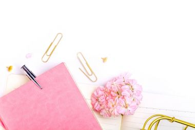 Notebook, pen and pink flowers on white background stock vector