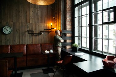 Fashionable man in loft-styled cafe