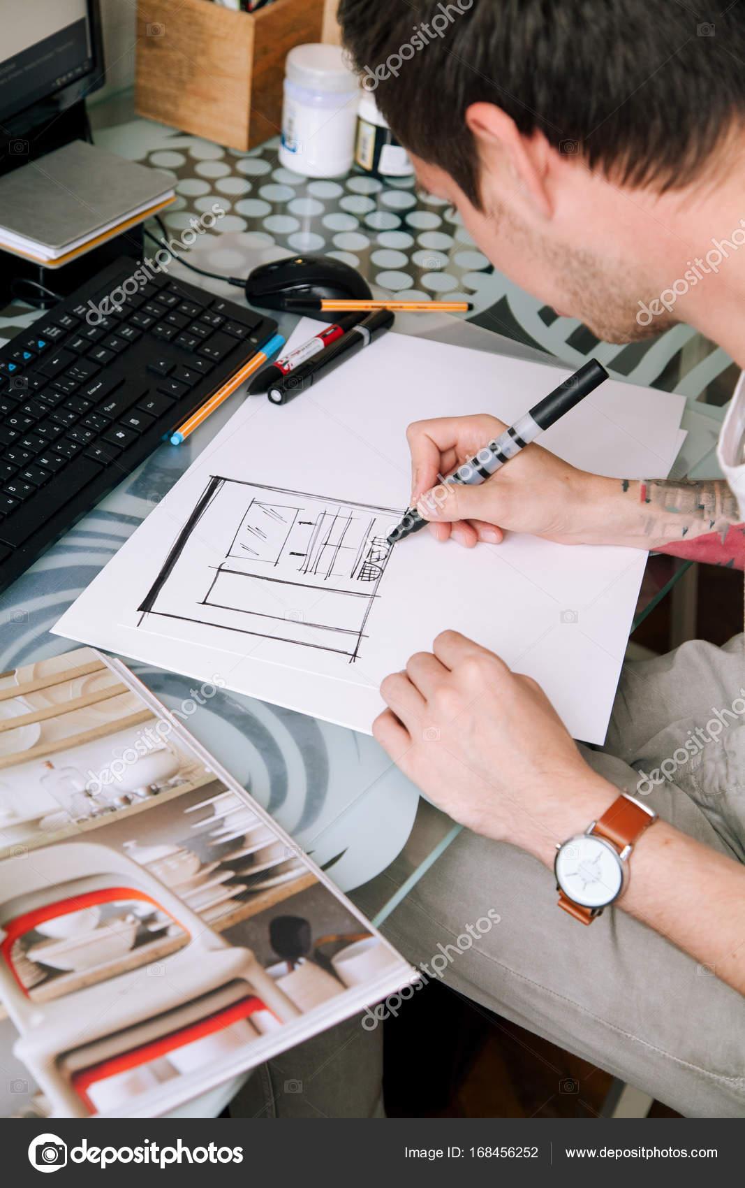 designer making sketch of interior project with black marker nice tattoo on his arm natural daylight photo by asinskki - Freelance Interior Design Work